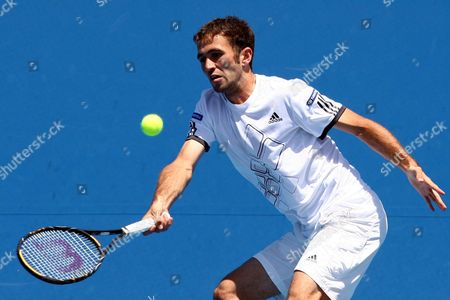 Marsel Ilhan of Turkey Hits a Shot Against Sebastien Grosjean of France During Their First Round Match at the Australian Open Tennis Tournament in Melbourne Australia on 19 January 2010 Australia Melbourne