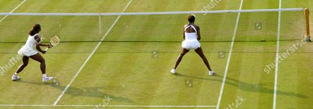 Serena (l) and Venus Williams of the Usa During Their Ladies Doubles Second Round Match Against Timea Bacsinszky of Switzerland and Tathiana Garbin of Italy For the Wimbledon Championships at the All England Lawn Tennis Club in London Britain 25 June 2010 United Kingdom Wimbledon