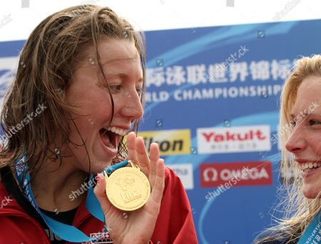 Swann Oberson of Switzerland As She Celebrates with Her Gold Medal with Bronze Medalist Ashley Grace Twichell of the United States (r) at the Medal Ceremony in the 5 Km Women's Open Water Swimming Event at the Fina Swimming World Championships at Jinshan Beach Shanghai China on 22 July 2011 China Shanghai