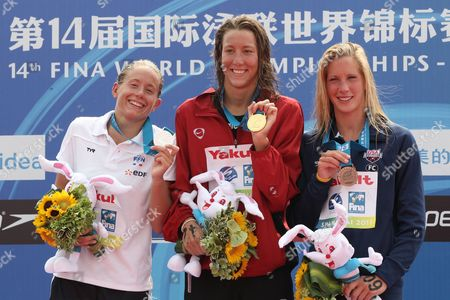 Swann Oberson of Switzerland (c) with Gold Medal and Silver Medalist Aurelie Muller of France (l) and Bronze Medalist Ashley Grace Twichell of the United States (r) During the Medal Ceremony For the 5 Km Women's Open Water Swimming Event at the Fina Swimming World Championships at Jinshan Beach Shanghai China on 22 July 2011 China Shanghai