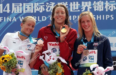 Swann Oberson of Switzerland (c) with Gold Medal and Silver Medal Winner Aurelie Muller of France (l) and Bronze Medal Winner Ashley Grace Twichell of the United States (r) During the Medal Ceremony For the 5 Km Women's Open Water Swimming Event at the Fina Swimming World Championships at Jinshan Beach Shanghai China on 22 July 2011 China Shanghai