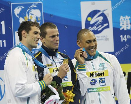 (l-r) Silver Medalist Matthew Targett of Australia Gold Medalist Cesar Cielo Filho of Brazil and Bronze Medalist Geoff Huegill of Australia Hold Up Their Medals at a Prize Ceremony For the 50m Mens Butterfly Swimming Finals at the 2011 Fina World Swimming Championships in Shanghai China on 25 July 2011 China Shanghai