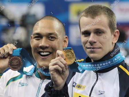Bronze Medalist Geoff Huegill (l) of Australia and Gold Medalist Cesar Cielo Filho (c) Brazil Hold Up Their Medals After a Prize Ceremony For the 50m Mens Butterfly Swimming Finals at the 2011 Fina World Swimming Championships in Shanghai China on 25 July 2011 China Shanghai