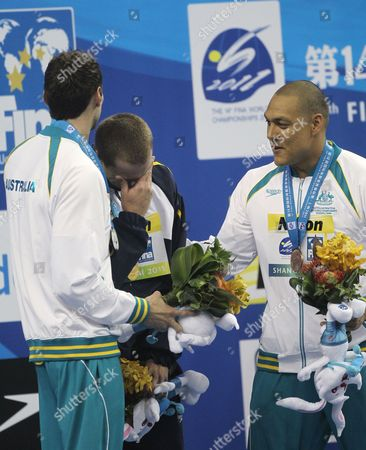 Silver Medalist Matthew Targett (l) and Bronze Medalist Geoff Huegill (r) of Australia Comfort Gold Medalist Cesar Cielo Filho (c) of Brazil at a Prize Ceremony For the 50m Mens Butterfly Swimming Finals at the 2011 Fina World Swimming Championships in Shanghai China on 25 July 2011 China Shanghai