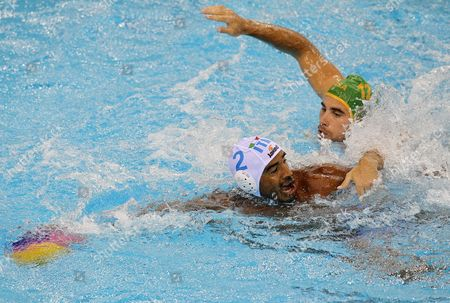 Amaurys Perez (l) of Italy and Nicholas Jon Mol Yneux (r) of South Africa Vie For the Ball During Their Men's Water Polo Preliminary Match During the Fina Swimming World Championships in Shanghai China 18 July 2011 China Shanghai