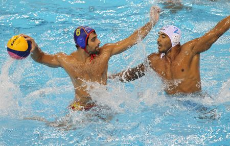 Amaurys Perez of Italy (white) and Marc Minguell Alferez of Spain Vie For the Ball During Their Men's Water Polo Quarter Final Match at the 2011 Fina World Swimming Championships in Shanghai China on 26 July 2011 China Shanghai