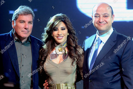 A Picture Made Available on 11 January 2011 Shows Lebanese Tv Presenter Ali Jaber (l) Lebanese Singer Najwa Karam (c) and Egyptian Tv Presenter Amr Adib (r) Posing For a Photograph During a Press Conference at the Grand Hyatt Hotel in Cairo Egypt 10 January 2011 Karam and Wadib Announced They Will Present a New Tv Program That Will Be Aired on Arab Channel Mbc4 Entitled 'Talents' the Show Will Select the Best Artists in Various Domains As Music Theatre Poetry and Others Egypt Cairo