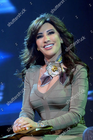 A Picture Made Available on 11 January 2011 Shows Lebanese Singer Najwa Karam Posing For a Photograph During a Press Conference at the Grand Hyatt Hotel in Cairo Egypt 10 January 2011 Karam and Wadib Announced They Will Present a New Tv Program That Will Be Aired on Arab Channet Mbc4 Entitled ' Talents' the Show Will Select the Best Artists in Various Domains As Music Theatre Poetry and Others Egypt Cairo