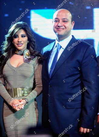 A Picture Made Available on 11 January 2011 Shows Lebanese Singer Najwa Karam (l) and Egyptian Tv Presenter Amr Adib (r) Posing For a Photograph During a Press Conference at the Grand Hyatt Hotel in Cairo Egypt 10 January 2011 Karam and Wadib Announced They Will Present a New Tv Program That Will Be Aired on Arab Channet Mbc4 Entitled ' Talents' the Show Will Select the Best Artists in Various Domains As Music Theatre Poetry and Others Egypt Cairo