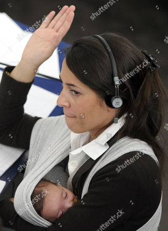 European Parliament Member Licia Ronzulli of the Group of the European People's Party Has Her Baby in a Wraparound Baby Reacts During the Vote Concerning the Legislation Extending the Minimum Period of Materny Leave During the Plenary Session at the European Parliament in Strasbourg France 20 October 2010 France Strasbourg