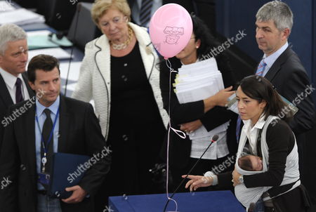 European Parliament Member Licia Ronzulli (r) of the Group of the European People's Party Has Her Baby in a Wraparound Baby Delivers Her Speech After the Vote Concerning the Legislation Extending the Minimum Period of Materny Leave During the Plenary Session at the European Parliament in Strasbourg France 20 October 2010 France Strasbourg