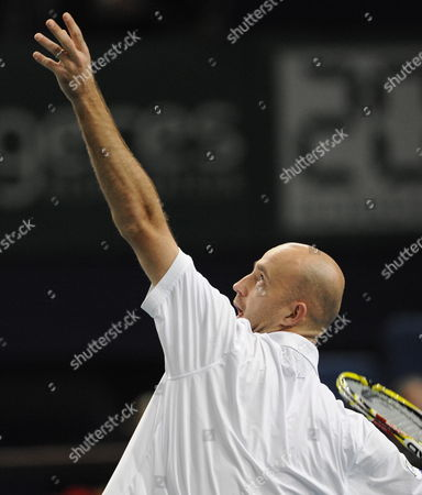 Ivan Ljubicic of Croatia Serves to Sebastien Grosjean of France During Their First Round Match at the Bnp Paribas Masters Tennis Tournament in Paris France 9 November 2009 France Paris