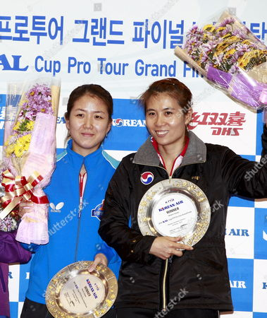 Stock Image of Winners South Korean Kim Kyung-ah and Park Mi-young Celebrate on the Podium at the Women's Double Final Table Tennis Match at the Olympic Gymnastic Stadium in Seoul South Korea 19 December 2010 South Korean Kim Kyung-ah and Park Mi-young Won the Match Korea, Republic of Seoul