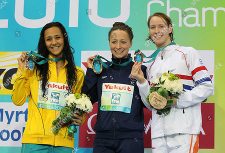 Stock Picture of Gold Medalist Ariana Kukors (c) of the Us is Flanked by Silver Medalist Kotuku Ngawati (l) of Australia and Bronze Medalist Hinkelien Schreuder (r) of the Netherlands After the Women's 100m Individual Medley Final Final of the 10th Fina Swimming Short Course World Championships at the Hamdan Bin Mohammed Bin Rashid Sports Complex in Dubai United Arab Emirates 17 December 2010 United Arab Emirates Dubai