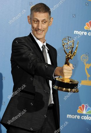 British Director Steve Shill Holds His Outstanding Directing For a Drama Series Award For His Work on 'Dexter' As He Poses For Photographers in the Press Room During the 62nd Annual Primetime Emmy Awards Held at the Nokia Theatre in Los Angeles California Usa 29 August 2010 the Primetime Emmy Awards Honor Excellence in Us Primetime Television Programming United States Los Angeles