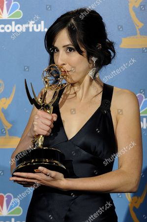 Stock Photo of Us Writer Erin Levy Holds Her Award For Outstanding Writing For a Drama Series For 'Mad Men - Shut the Door Have a Seat ' in the Press Room During the 62nd Annual Primetime Emmy Awards Held at the Nokia Theatre in Los Angeles California Usa 29 August 2010 the Primetime Emmy Awards Honor Excellence in Us Primetime Television Programming United States Hollywood