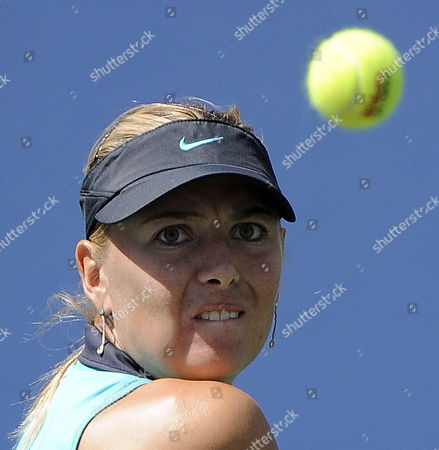 Maria Sharapova of Russia Focusses a Ball Before Returning to Beatrice Capra of the Us During Their Third Round Match at the 2010 Us Open Tennis Championship at the Usta National Tennis Center in Flushing Meadows New York Usa 04 September 2010 the Us Open Championship Runs Through 12 September when the Men's Final is Scheduled to Be Played United States Flushing Meadows