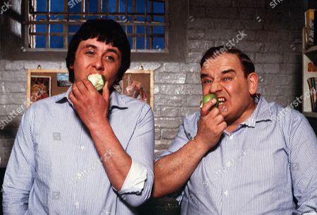 'Porridge'  Film - 1979 - Norman Stanley Fletcher (Ronnie Barker) and Lennie Godber (Richard Beckinsale) eat an apple each in their prison cell