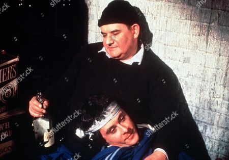 Stock Picture of 'Porridge'  Film - 1979 - A drunken Norman Stanley Fletcher (Ronnie Barker) and Lennie Godber (Richard Beckinsale) sit together.