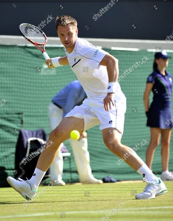 Robin Soderling of Sweden Returns to Bernard Tomic of Australia During Their Third Round Match For the Wimbledon Championships at the All England Lawn Tennis Club in London Britain 25 June 2011 United Kingdom Wimbledon