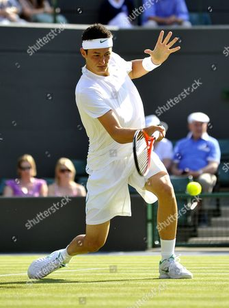 Bernard Tomic of Australia Returns to Robin Soderling of Sweden During Their Third Round Match For the Wimbledon Championships at the All England Lawn Tennis Club in London Britain 25 June 2011 United Kingdom Wimbledon