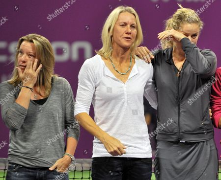Kim Clijsters of Belgium (r) Lisa Raymond of the United States (c) Rennae Stubbs of Australia (l) Cry After Russian Tennis Player Elena Dementieva Announced Her Retirement After Her Match Against Francesca Schiavone of Italy During Day Four of the Wta Championships at the Khalifa Tennis Complex Doha Qatar on 29 October 2010 Qatar Doha