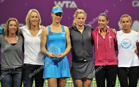 Russian Tennis Player Elena Dementieva (3rd L) Poses For Photos with Kim Clijsters of Belgium (4th L) and Other Top Tennis Plyers After Announcing Her Retirement Following Her Wta Championships Match Against Italy's Francesca Schiavone During Day Four of the Wta Championships at the Khalifa Tennis Complex Doha Qatar on 29 October 2010 Qatar Doha
