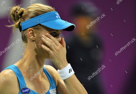 Stock Picture of Elena Dementieva of Russia Reacts During the Match Agains Francesca Schiavone of Italy During Their Match on the Fourth Day of the Wta Sony Ericsson Championships at the International Khalifa Tennis Complex Doha Qatar on 29 October 2010 Qatar Doha
