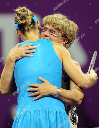 Elena Dementieva of Russia is Embraced by Her Mother Vera Dementieva After Announcing Her Retirement After Her Match Against Francesca Schiavone of Italy During Day Four of the Wta Championships at the Khalifa Tennis Complex Doha Qatar on 29 October 2010 Qatar Doha