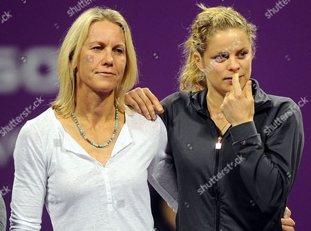 Stock Picture of Lisa Raymond of the United States (l) Kim Clijsters of Belgium (r) Cries After Russian Tennis Player Elena Dementieva Announced Her Retirement After Her Match Against Francesca Schiavone of Italy During Day Four of the Wta Championships at the Khalifa Tennis Complex Doha Qatar on 29 October 2010 Qatar Doha