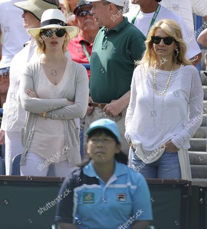 Us Actress January Jones (l) and Us Producer and Hollywood Costume and Wardrobe Department Karyn Fields on Center Court During the Novak Djokovic of Serbia Versus Roger Federer of Switzerland Singles Semifinals Match at the Bnp Paribas Open in Indian Wells California Usa 19 March 2011 United States Indian Wells