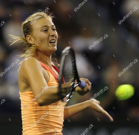 Maria Sharapova of Russia Hits a Forehand Against Dinara Safina of Russia at the Bnp Paribas Open in Indian Wells California Usa 15 March 2011 United States Indian Wells