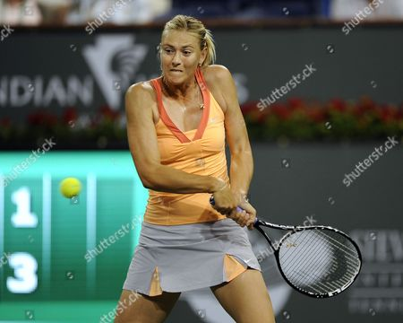 Maria Sharapova of Russia Returns a Shot to Dinara Safina of Russia During Their Match at the Bnp Paribas Open in Indian Wells California Usa 15 March 2011 United States Indian Wells