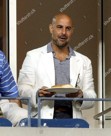 Stock Picture of Us Actor Stanley Tucci Watches Justine Henin of Belgium Play Dinara Safina of Russia During Their Fourth Round Match On the Seventh Day of the 2007 Us Open Tennis Tournament in Flushing Meadows New York Usa 02 September 2007