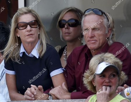 Us Tennis Legend Chris Evert (l) Sits with Australian Golfer Greg Norman (r) As They Watch Venus Williams of the Us Play Justine Henin of Belgium During Their Semifinal Match On the Twelfth Day of the 2007 Us Open Tennis Tournament in Flushing Meadows New York Usa 07 September 2007