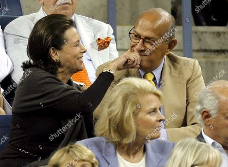 Annette De La Renta Wipes at Her Husband Oscar De La Renta's Mouth As They Watch Novak Djokovic of Serbia Play Carlos Moya of Spain During Their Quarterfinals Round Match On the Eleventh Day of the 2007 Us Open Tennis Tournament in Flushing Meadows New York Usa 06 September 2007 the Man at Right is Unidentified