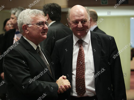 Stock Photo of Eu Health and Consumer Policy Commissioner John Dalli Chats with British Minister of State For the Department For Environment Food and Rural Affairs James Paice (r) at the Start of an Eu Agriculture Ministers Council in Brussels Belgium 24 January 2011 Belgium Brussels