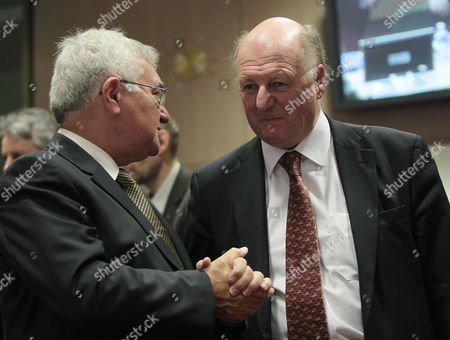 Stock Image of Eu Health and Consumer Policy Commissioner John Dalli Chats with British Minister of State For the Department For Environment Food and Rural Affairs James Paice (r) at the Start of an Eu Agriculture Ministers Council in Brussels Belgium 24 January 2011 Belgium Brussels