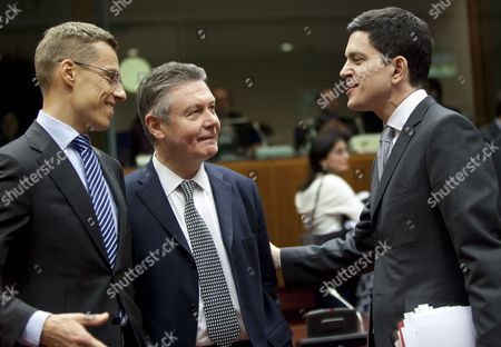 (l to R) Finnish Foreign Minister Alexander Stub European Commissioners For Development and Humanitarian Aid Belgian Karel De Gucht Britain's Foreign Secretary David Miliband at the Start of the Eu Foreign Affairs Council in Brussels Belgium 25 January 2010 Iran Will Be on the Agenda As Member States Consider How to the Eu Can Put More Pressure on Tehran to End Its Controversial Nuclear Programme the Ministers' Meeting Comes Six Weeks After Eu Leaders Issued a Statement at a Summit in Brussels in December Saying the Bloc Would Be Prepared to Back Un Sanctions on the Issue They Asked Foreign Ministers 'To Consider Options For Next Steps to This End' Belgium Brussels