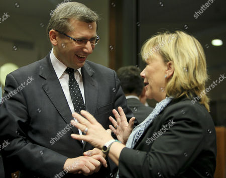 Polish Justice Minister Krysztof Kwiatkowski (l) Chats with Swedish Justice Minister Beatrice Ask at the Start of a European Interior Home Affairs and Justice Ministers Council at the Eu Headquaters in Brussels Belgium 09 November 2010 Belgium Brussels