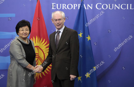 President of Kyrgyzstan Roza Otunbaeva is Welcomed by President of the European Council Belgian Herman Van Rompuy (r) Prior to a Meeting at the Eu Council Headquarters in Brussels Belgium 01 March 2011 Belgium Brussels