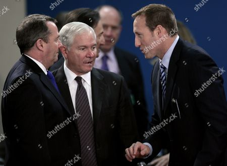 (l to R) British Defence Minister Liam Fox Us Defence Secretary Robert Gates and Canada Defence Minister Peter Gordon Mackay Chat During a Nato Defence Ministers Meeting at the Nato Headquarters in Brussels Belgium 10 March 2011 Nato Members Begin Two Days of Talks on Libya to Discuss the Possibility of Imposing a No-fly Zone to Stop Air Attacks by Forces Supporting Libyan Leader Moammar Gaddafi Belgium Brussels