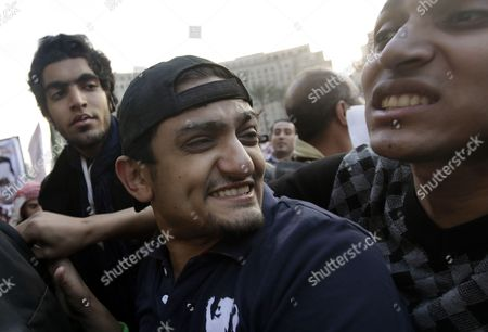Egyptian Wael Ghonim (c) a Google Inc Marketing Manager For Northern Africa and the Middle East Smiles As He Leaves After Addressing a Crowd on Tahrir Square in Cairo Egypt As Thousands of Protestors Continued Their Anti-government Demonstrations on 08 February 2011 Ghorim who was Released From Police Custody on 08 February After Being Arrested on 28 January is Regarded As a Leading Force Behind the Internet Campaigns That Helped the Anti-mubarak Movement Gain Momentum Egypt Cairo