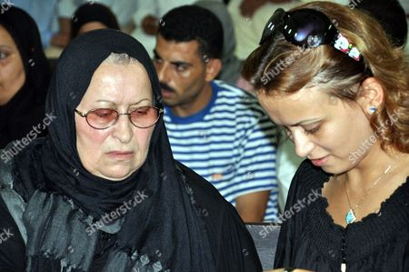 Stock Picture of Layla Qasim (l) and Zahra (r) Mother and Sister of 28-year-old Khaled Said Respectively Attend the Trial of the Egyptian Police Officers who Are Accused of Illegal Arrest and Using Physical Torture and Brutality Which Led to the Death of Said Egypt 27 July 2010 Said Died in Early June After Two Plain-clothes Policemen Reportedly Beat Him in Alexandria His Family and Activists Say the Interior Ministry Has Denied the Allegations Saying That He Died From Asphyxiation After He Swallowed a Packet of Drugs He was Carrying when Police Tried to Arrest Him a Second Autopsy Report Supported the Initial Statement the Ministry Said Saids Death Sparked Protests Across the Country While the United States the European Union and Human Rights Groups Have Called For a Transparent Investigation Egypt Alexandria