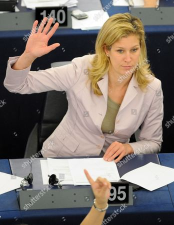 German Eu Deputy Silvana Koch-mehrin Votes During the Plenary Session of the European Parliament in Strasbourg France 11 May 2011 the German Newspaper Sueddeutsche Zeitung Reported 11 May 2011 That Koch-mehrin is to Be Asked to Defend Herself Against Charges of Plagiarism in Her Doctoral Dissertation the Charges Are Serious Enough For Heidelberg University to Consider Revoking Koch-mehrin's Doctorate if She Doesn't Provide an Adequate Explanation the Newspaper Reported Without Citing a Source France Strasbourg