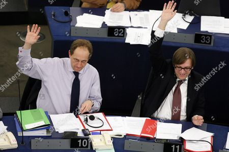 Group of the Alliance of Liberals and Democrats For Europe Alexander Graf Lambsdorff (l) and Guy Verhofstad (r) of Group of the Alliance of Liberals and Democrats For Europe Vote in Favour of the Propositions For the Situations in Iran Yemen Haiti and the Results of the Copenhagen Summit During the Plenary Session in Strasbourg 10 February 2010 the European Parliament Approved 09 February the New European Commission Led by Former Portuguese Prime Minister Jose Manuel Barroso Clearing the Way For It to Take Office For the Next Five Years France Strasbourg