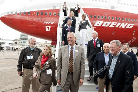 In the Center W James Mcnerney Jr Chairman President and Chief Executive Officernext to Elizabeth Lund Vice President of Product Development For Commercial Airplanes Leave a New Model of a Boeing 747 at the Paris Air Show 2011 Paris France 19 June 2011 According to the Organizers the Trade Show From 20 to 26 June Will Feature 28 International Pavilions 140 Aircraft Including an Exceptional Appearance by the Solar Aircraft 'Solar Impulse' Jobs and Training Area an 'Alternative Aviation Fuels' Village and the Opportunity to Visit the Air and Space Museum the International Paris Air Show at Le Bourget is Expected to Be Visited by 138 000 Professional Visitors and 200 000 General Public Visitors France Paris