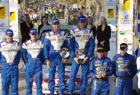 Limassol Cyprus : (l-r) Runners Up Robert Reid and Driver Richard Burns of Great Britain Winners Timo Rautiainen and Marcus Gronholm of Finland and Kaj Lindstrom and Tommi Makkinen Also From Finland in Third Place on the Podium Following the Final Stage of the Cyprus Rally in Limassol 21 April 2002