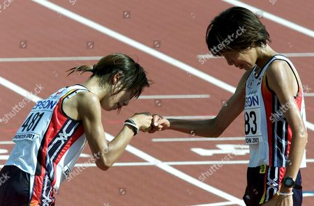 Edmonton Canada : Edm11-20010812-edmonton Canada: Japanese Runners Yoko Shibui (left) and Reiko Tosa Congratulate Each Other After Finishing Womens Marathon at the World Athletics Championships in Edmonton Sunday 12 August 2001 Lidia Simon of Romania Won the Race Ahead of Reiko Tosa of Japan and Svetlana Zakharova of Russia Yoko Shibui Finished 4th