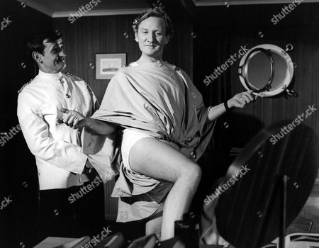 'Doctor In Trouble'   Film Graham Stark (left) with Leslie Phillips